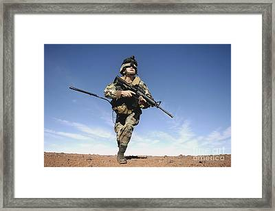 A Soldier Moves To Another Firing Framed Print by Stocktrek Images