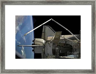 A Soyuz Vehicle And The Space Shuttle Framed Print by Stocktrek Images