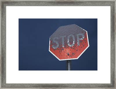 A Stop Sign Covered In Snow Framed Print by John Burcham
