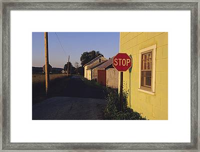 A Stop Sign In A Rural Alley Framed Print by Raymond Gehman