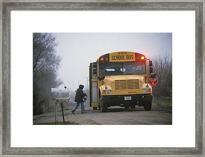A Student Boards A School Bus Framed Print by Joel Sartore