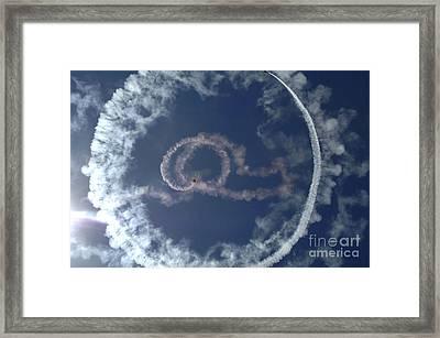 A Stunt Plane Flies Framed Print by Stocktrek Images