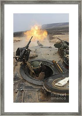A Tank Crewman Braces Himself Framed Print by Stocktrek Images