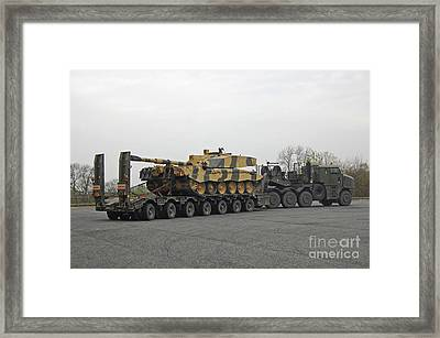 A Tank Transporter Hauling A Challenger Framed Print by Andrew Chittock