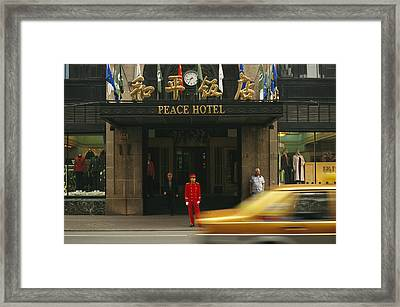 A Taxi Drives Past Shanghais Famous Framed Print by Justin Guariglia