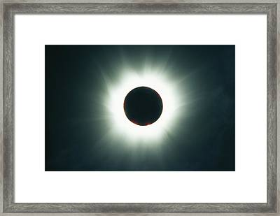 A Total Solar Eclipse Over France Framed Print by Carsten Peter