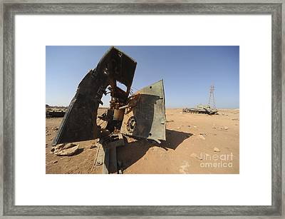 A Tracked Artillery Vehicle Destroyed Framed Print by Andrew Chittock