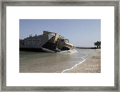 A Truck Offloads From A Landing Craft Framed Print by Stocktrek Images