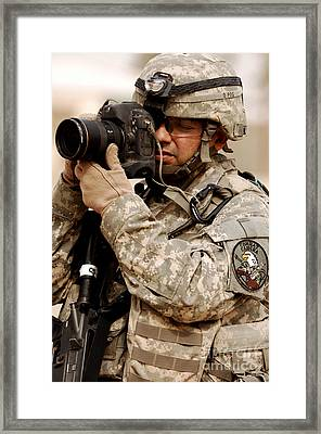 A U.s. Air Force Combat Cameraman Framed Print by Stocktrek Images