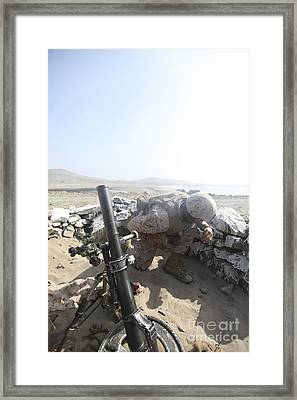 A U.s. Marine Fires A Mortar Round Framed Print by Stocktrek Images