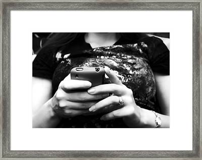 A Woman And Her Phone Framed Print by Ricky Barnard