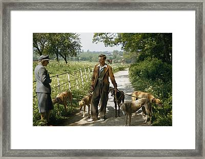 A Woman Talks With A Man Walking Racing Framed Print by B. Anthony Stewart
