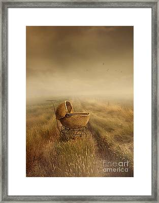 Abandoned Antique Baby Carriage In Field Framed Print by Sandra Cunningham