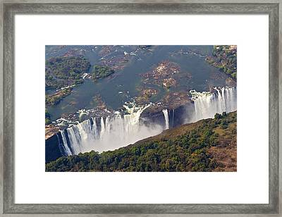 Aerial Of Victoria Falls, Zambia, Africa Framed Print by Yvette Cardozo
