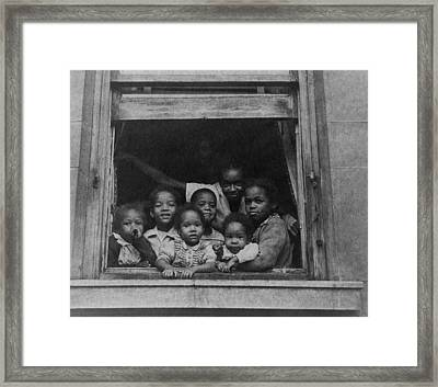 African American Woman And Six Children Framed Print by Everett
