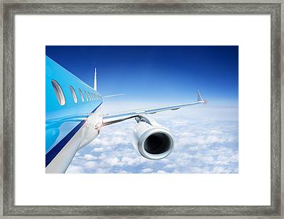 Airliner In Flight Above The Clouds Framed Print by Corepics