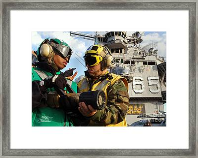 Airman Receives Proper Fire Fighting Framed Print by Stocktrek Images