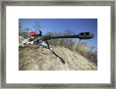 Airman Sights A .50 Caliber Sniper Framed Print by Stocktrek Images