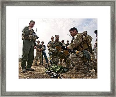 Airmen Explain Their Evidence Gathering Framed Print by Stocktrek Images
