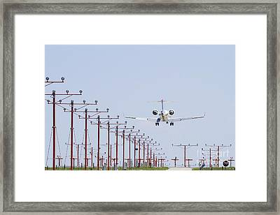 Airplane Landing Framed Print by Jeremy Woodhouse