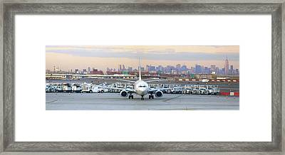 Airport Overlook The Big City Framed Print by Mike McGlothlen