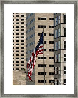 American Flag In The City Framed Print by Blink Images