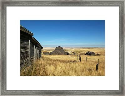 An Abandoned Farm In Canadas Prairies Framed Print by Pete Ryan