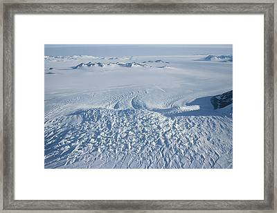 An Aerial View Of Crevasses In A Polar Framed Print by Gordon Wiltsie