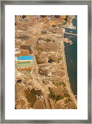 An Aerial View Of Tsunami Damage North Framed Print by Everett