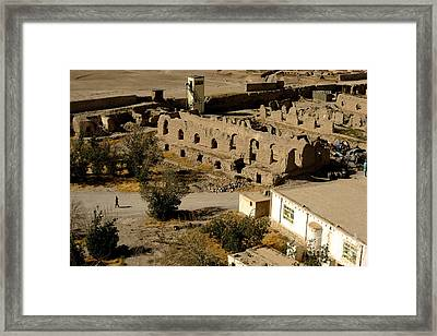An Afghan National Army Soldier Walks Framed Print by Stocktrek Images