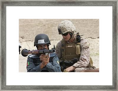 An Afghan Police Student Aiming A Rpg-7 Framed Print by Terry Moore