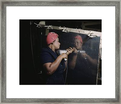 An African American Rosy The Riveter Framed Print by Everett