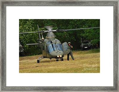 An Agusta A109 Helicopter Framed Print by Luc De Jaeger