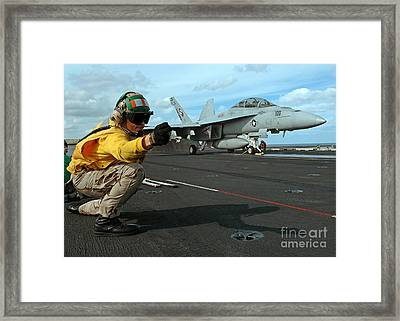 An Airman Gives The Signal To Launch An Framed Print by Stocktrek Images
