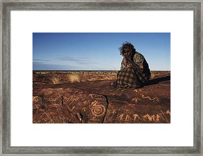 An Eastern Arrernte Woman Ponders Framed Print by Medford Taylor