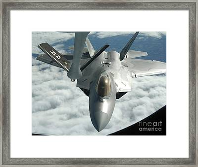 An F-22a Raptor Refuels With A Kc-135 Framed Print by Stocktrek Images