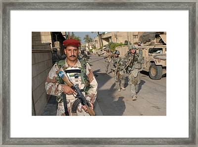 An Iraqi Soldier Leads The Way Framed Print by Everett