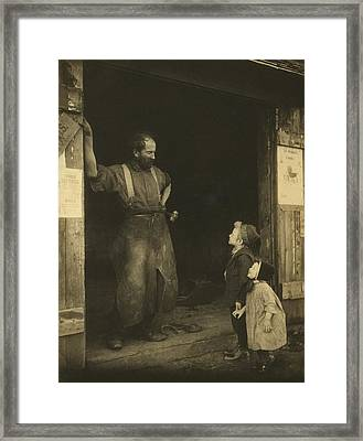 An Leather Aproned Blacksmith Framed Print by Everett