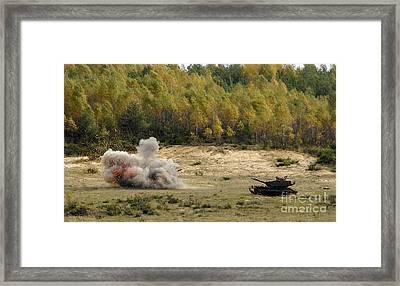 An M60 Patton Tank Explodes Framed Print by Stocktrek Images