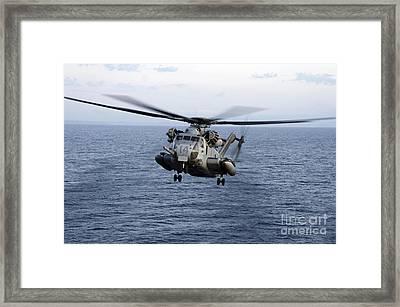 An Mh-53e Sea Dragon In Flight Framed Print by Stocktrek Images