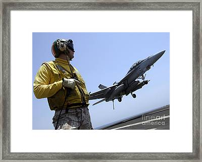 An Officer Observes An Fa-18f Super Framed Print by Stocktrek Images