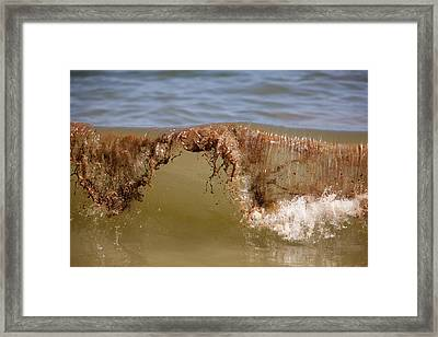 An Oily Wave Breaks On The Beach Framed Print by Tyrone Turner