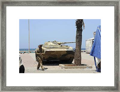 An Old Russian Bmp Armored Personnel Framed Print by Andrew Chittock