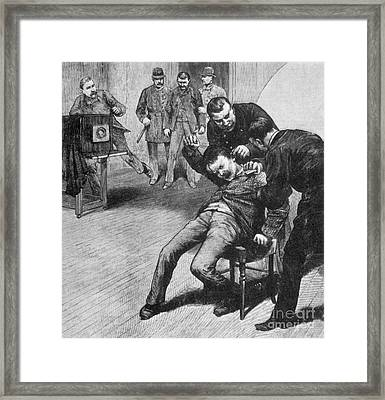 Anarchist Being Held Down For Mug Shot Framed Print by Photo Researchers