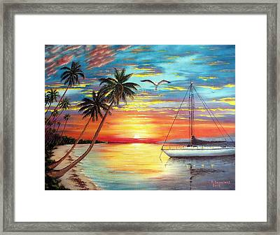Anchored At Sunset Framed Print by Riley Geddings