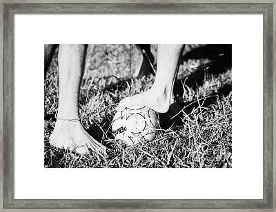 Argentinian Hispanic Men Start A Football Game Barefoot In The Park On Grass Framed Print by Joe Fox