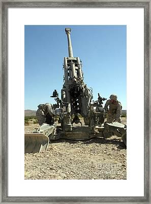 Artillerymen Manning The M777 Framed Print by Stocktrek Images