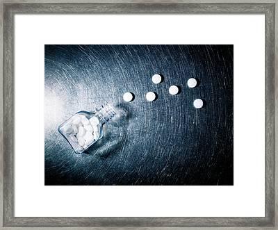 Aspirin Spilled From Bottle On Stainless Steel. Framed Print by Ballyscanlon