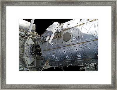 Astronaut Traverses Along The Destiny Framed Print by Stocktrek Images