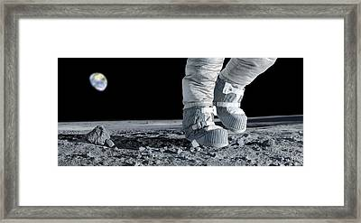 Astronaut Walking On The Moon Framed Print by Detlev Van Ravenswaay